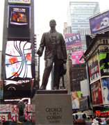 "George M. Cohan was a famous figure in the New York City theater scene. Little Johnny Jones, his first big Broadway hit introduced his songs ""Give My Regards To Broadway"" and ""The Yankee Doodle Boy"". His statue was errected in the 1960s in recognition of musical contributions to the war effort through his songs ""You're a Grand Old Flag"" and ""Over There."""